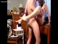 Teenage amateur couple having a quickie on the desk