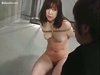 Japanese girl gets tied up in and hung upside down