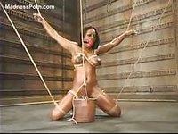 Busty Ebony loves bondage fun
