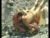 Hardcore bi-sexual threesome captured by a voyeur on a public beach