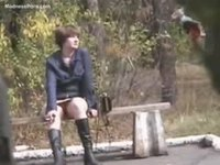 Well skilled voyeur peeking up the skirt up an unsuspecting girl sitting on a bench