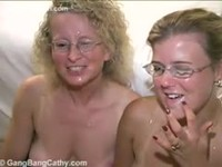 Two married woman getting facial cumshots after their gangbang fuck session