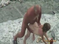 Older dude face fucking and screwing a teen slut on the beach
