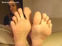 Delightful teenage newcomer pleasing her foot fetish lovers during a live webcam session