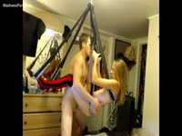 Happy dude pounding his skinny blonde girlfriend in a sex swing