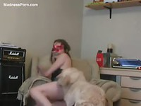Barely eighteen year old girl in a mask lifts her skirt so her dog can fuck her