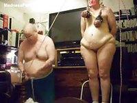 Old dude putting a plump mature slut through breast torture