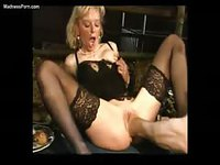Stunning blonde cougar getting fist fucked while sucking dick