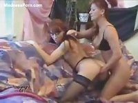 Couple of stunning redheaded mature hotties in black nylons enjoy fisting play
