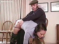 Unhappy man pulls down pretty girls panties and gives her a proper spanking