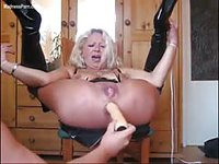 Mature blonde amateur in bdsm having her holes toy fucked