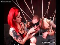 Submissive skinny guy bound with many ropes and teased