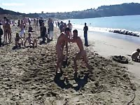 Naked public fight near the sea