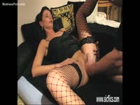 Skinny short hair cougar with long legs wearing stockings while taking a pussy fisting insertion