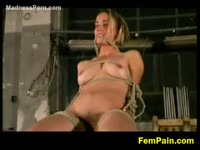 All natural once shy college girl in BDSM restraints painfully lashed by an aggressive dude