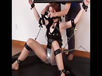 Helpless long legged redhead beauty probed and pleasured while bound in BDSM restraints