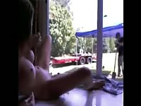 Risky small breasted all natural leggy teen masturbates in front of a glass window while live