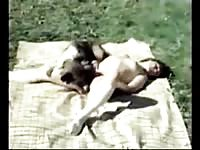 Old school animal fetish movie features spread eagle teen eaten outdoors by her horny dog